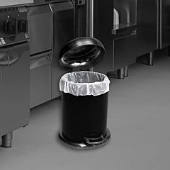 Black and white image of a pedal bin with a white bin bag.