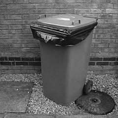 Wheelie bin with a bag.